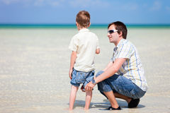 Father and son at shallow water Royalty Free Stock Images