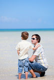 Father and son at shallow water Royalty Free Stock Image