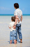 Father and son at shallow water Stock Photography