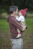 Father and son. A Father shares a kiss with his young toddler son Stock Images