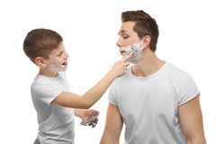 Father and son shaving. On white background Royalty Free Stock Images