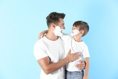 Father and son with shaving foam royalty free stock photography