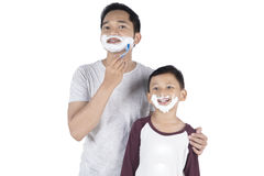 Father and son with shaving foam Royalty Free Stock Images