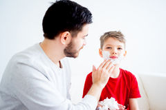 Father and son shaving. Father teaching his son to shave and having fun together Royalty Free Stock Photos