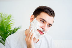 Father and son shaving. Father teaching his son to shave and having fun together Royalty Free Stock Image