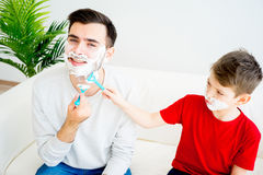Father and son shaving Royalty Free Stock Image