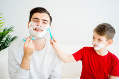 Father and son shaving Stock Photo