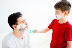 Father and son shaving Royalty Free Stock Images
