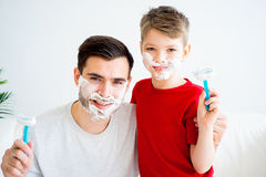 Father and son shaving Stock Photography