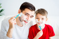 Father and son shaving Stock Image