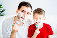 Father and son shaving Stock Photos