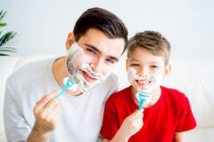 Father and son shaving Royalty Free Stock Photos