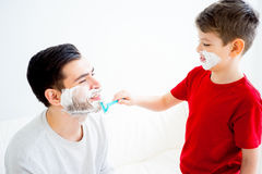 Father and son shaving Royalty Free Stock Photo