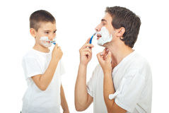 Father and son shaving together. Father teaching his son to shave isolated on white background Royalty Free Stock Photos