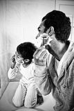 Father and son shaving together royalty free stock photography