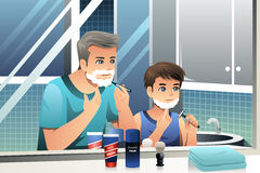 Father and son shaving together. A vector illustration of Father and son shaving together in bathroom Royalty Free Stock Photography