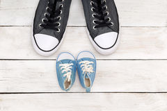 Father and son  shoes on white wooden background, father's day Royalty Free Stock Photos