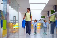 Father and son shopping together in mall Stock Images