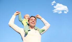 Father with son on shoulders Stock Images