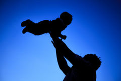 Father and son silhouette on sunset Royalty Free Stock Photo