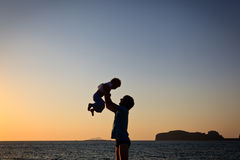 Father and son silhouettes at the beach stock photos