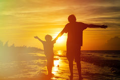 Father and son silhouettes play at sunset Stock Photography