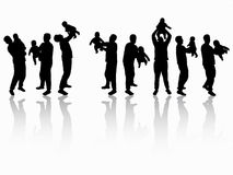 Father and son silhouettes together Royalty Free Stock Photo