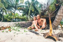 Father and son sit together on selfmade hut and play as Robinzon. Es Royalty Free Stock Photography