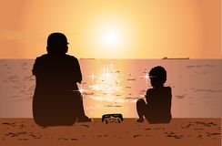 Father and son sitting on the beach, watching sunset Stock Photography