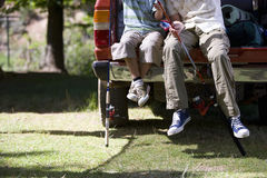 Father and son sitting with fishing poles on edge of truck bed stock photos