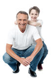 Father and son sitting on floor Stock Images