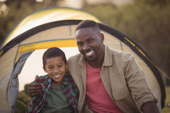 Father and son sitting in park Stock Image