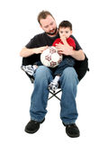 Father And Son Sitting Together In Chair Stock Photography