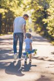 Father and son with a skateboard royalty free stock photos