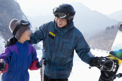 Father and Son with Ski Gear in Ski Resort Royalty Free Stock Photography
