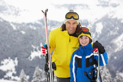 Father And Son On Ski Holiday In Mountains. Having Fun Stock Photos