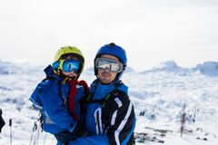 Father and son, skiing happily in Austrian ski resort in the mou Royalty Free Stock Image