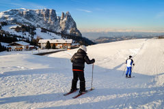 Father and son skiing on the snowy slopes of the Alps. ORTISEI, ITALY - CIRCA DECEMBER 2012: Father and son skiing on the snowy slopes of the Alps Stock Image
