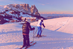 Father and son skiing on the snowy slopes of the Alps. ORTISEI, ITALY - CIRCA DECEMBER 2012: Father and son skiing on the snowy slopes of the Alps Royalty Free Stock Image