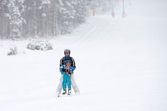 Father and son, skiing in the winter, boy learning to ski Royalty Free Stock Images