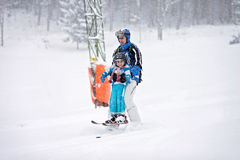 Father and son, skiing in the winter, boy learning to ski. Going on ski for the first time Stock Image