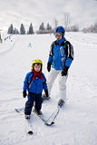 Father and son, skiing in the winter, boy learning to ski, going. On ski for the first time Royalty Free Stock Photo