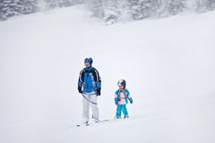 Father and son, skiing in the winter, boy learning to ski. Going on ski for the first time Stock Images