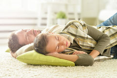 Father and son sleeping at home Stock Image