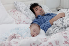Father and son sleeping together Stock Photos
