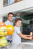 Father and son smile cooking home kitchen Royalty Free Stock Image
