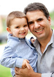 Father and son smiling Stock Image