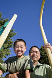 Father and Son Smiling on Jungle Gym - Vertical Stock Photography