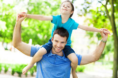 Father and Son. Smiling outdoors Royalty Free Stock Image