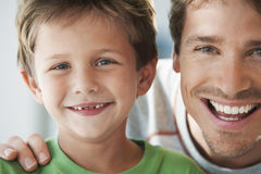 Father And Son Smiling Together Royalty Free Stock Photo
